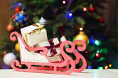 Decorative sledge with gifts — Stock Photo