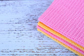 Colorful napkins on wooden table — Stock Photo