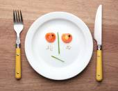 Vegetable face on plate — Stock Photo