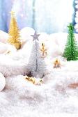 Decorative Christmas tree on snow close-up — Stock Photo