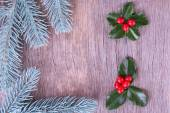 Frame with European Holly (Ilex aquifolium) with berries on wooden background — Stock Photo
