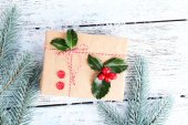 Cristmas gift with European Holly — Stock Photo