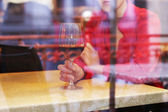 Woman with glass of wine in restaurant — Stock Photo