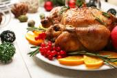 Baked chicken for festive dinner. Christmas table setting — Stock Photo