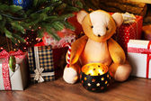 Teddy bear and gift boxes — Stock Photo