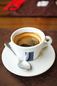 Cup of tasty coffee in cafe — Stock Photo