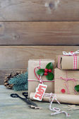 Beautiful Christmas composition with handmade gifts on wooden background — Zdjęcie stockowe