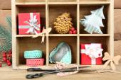 Christmas gifts in wooden crate — Stock Photo