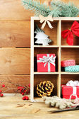 Christmas gifts in wooden crate — 图库照片