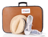 Travel suitcase with hat and shoes — Stock Photo