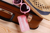Suitcase and tourist stuff — Stock Photo