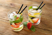 Cocktails with ice cubes — Stock Photo