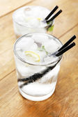 Glasses of water with ice cubes — Stock Photo
