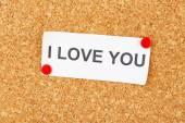 Paper sheet with declaration of love on wooden background — Stock Photo