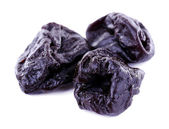 Three prunes isolated on white — Stock Photo