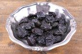 Metal plate of prunes — Stock Photo