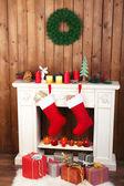 Christmas socks on fireplace — Stock Photo