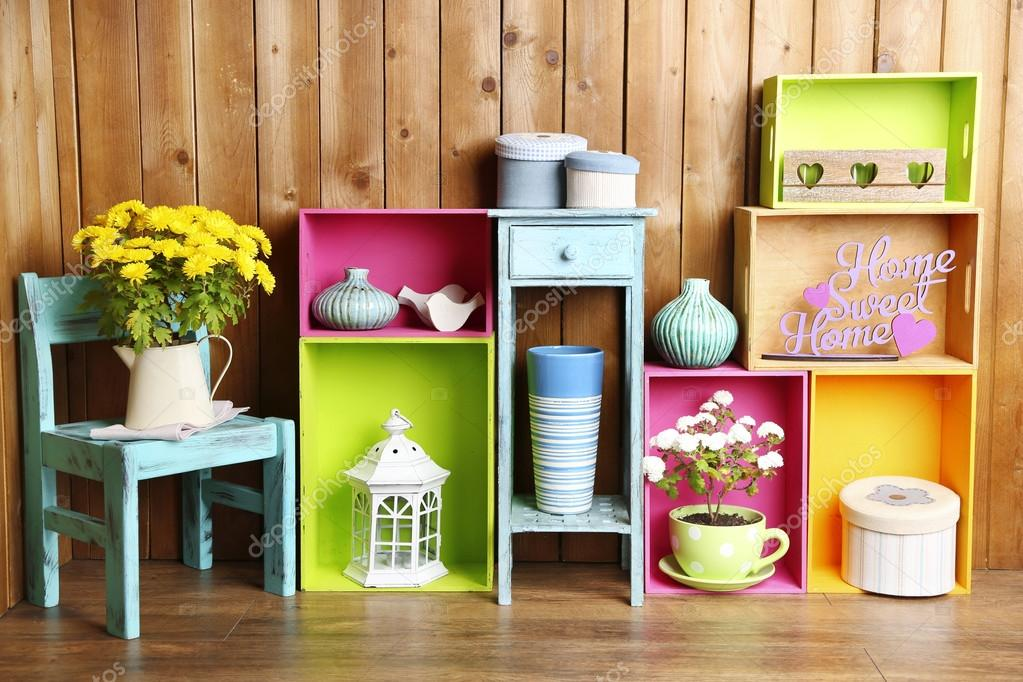 Beautiful colorful shelves with different home related objects on wooden wall background stock - Beautiful photoshelves ...