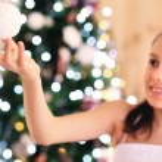 Cute little girl decorating Christmas tree — Stock Photo #61092071