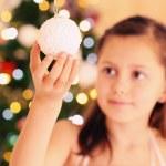 Cute little girl decorating Christmas tree — Stock Photo #61092073