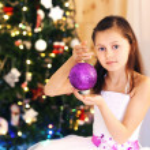 Cute little girl decorating Christmas tree — Stock Photo #61092077