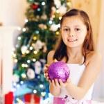 Cute little girl decorating Christmas tree — Stock Photo #61092081