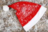 Santa red hat with snowflakes — Stock Photo