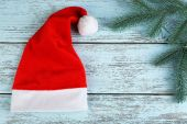 Santa hat with branch of fir-tree — Stock Photo