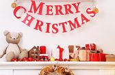Christmas decoration on mantelpiece on white wall background — Stock Photo