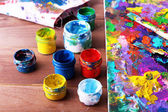 Abstract painting on canvas with cans — Stock Photo
