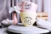 Emotional cups on table — Fotografia Stock