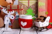 Hand-made Christmas gifts with decorations on wooden background — Stockfoto