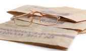 Glasses and newspapers close up — Stock Photo