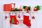 Mantelpiece with gifts and Christmas decoration — Stock Photo