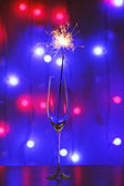 Beautiful sparkler in glass on shiny background, close up — Stock Photo