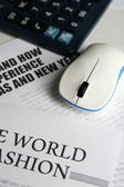 On-line news concept. Computer mouse and newspaper on wooden table background — Stock Photo