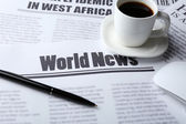 On-line news concept. Computer mouse, cup of coffee and newspaper, close-up — Stock Photo