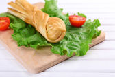 Smoked braided cheese on wooden table — Stock Photo