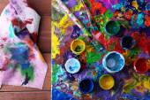 Abstract painting on canvas with cans, brush and rag on wooden table background — Stock Photo