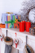 Mantelpiece with Christmas gifts — Stock Photo