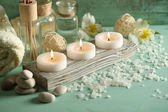 Candles, bottles sea salt — Foto de Stock