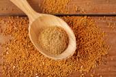 Mustard powder in wooden spoon — Stock Photo