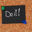 "Motivating paper sheet with inscription ""Do it"" on wooden background — Stock Photo #61211465"
