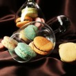 Gentle colorful macaroons in wine glass on color fabric background — Fotografia Stock  #61219151