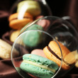 Gentle colorful macaroons in wine glass on color fabric background — Fotografia Stock  #61219153