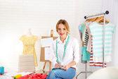Dressmaker in workroom — Stock Photo