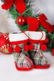 Christmas shoes on mantelpiece on white wall background — Stock Photo