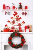 Christmas decorations on mantelpiece — Photo