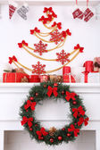 Christmas decorations on mantelpiece — Stock Photo