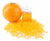 Orange essential oil with bath salt isolated on white — Stock Photo